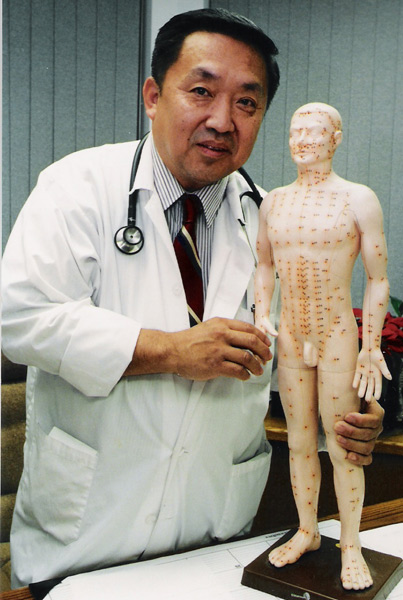 Dr-Aung-and-acupuncture-doll